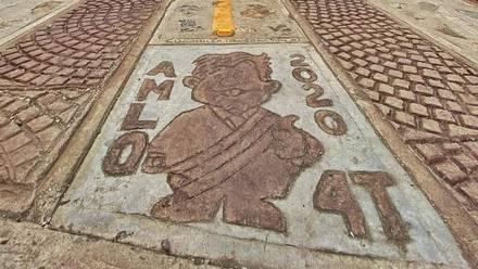 Dibujo de AMLO en carretera
